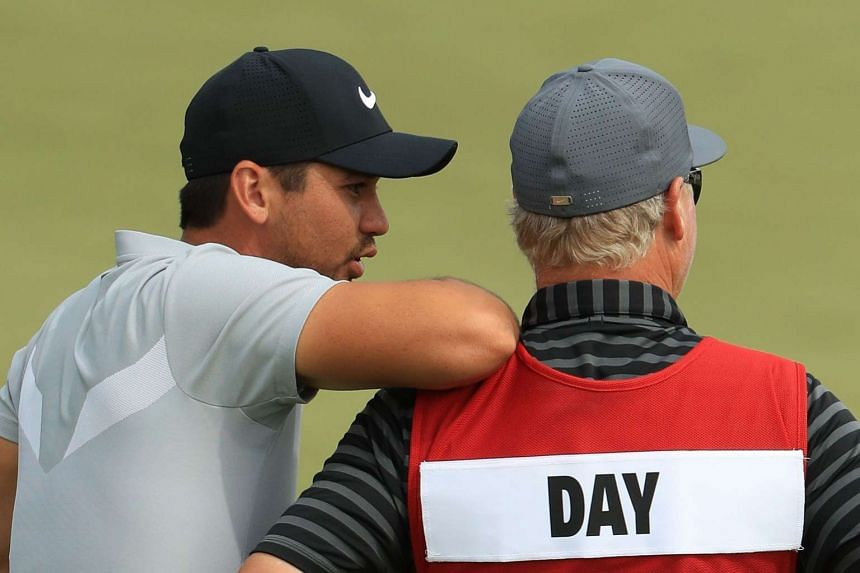 Day and caddie Col Swatton prepare to play his shot on the 15th hole during the second round.