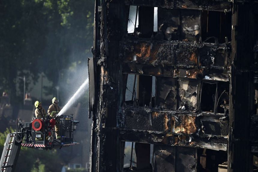 Firefighters fighting the blaze at Grenfell Tower. The social housing block is in a working-class enclave of the wealthy London borough of Kensington and Chelsea. The cladding used on the exterior walls of the tower block was not graded fire-resistan