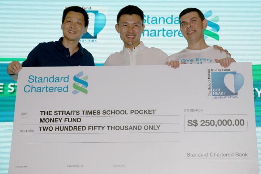 Standard Chartered Bank's head of Transaction Banking Goh Beng Kim (left), Parliamentary Secretary for Culture, Community and Youth Baey Yam Keng (centre), and The Straits Times' editor and chairman of the Straits Times School Pocket Money Fund Warre