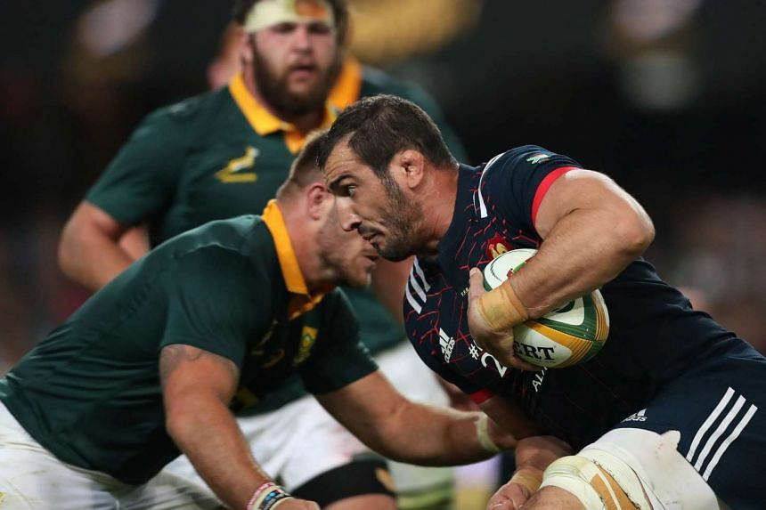 Yoann Maestri (right) of France tackled by Malcolm Marx of South Africa.