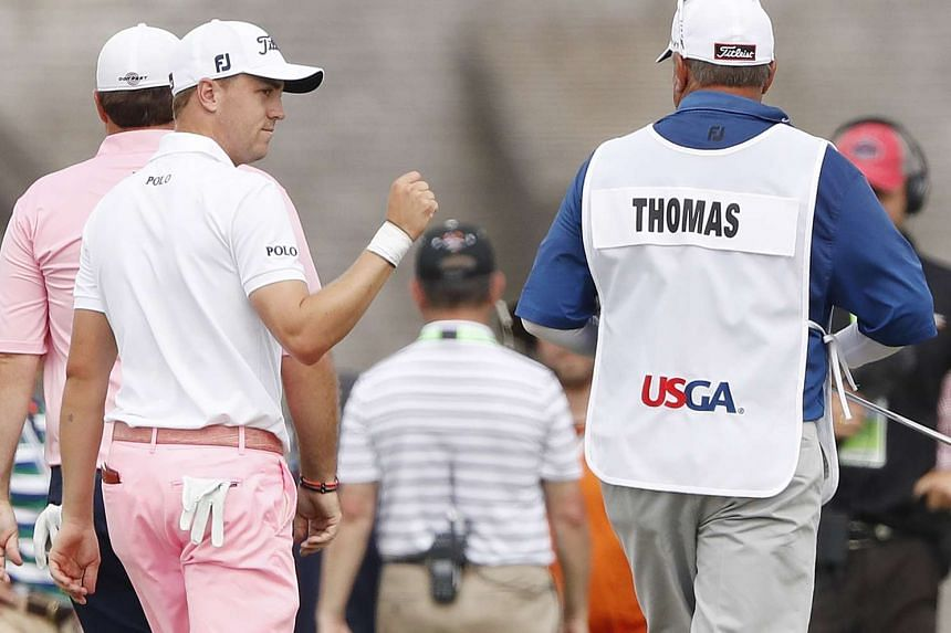 Thomas reacts after sinking his eagle putt for a 9-under round on the eighteenth hole.
