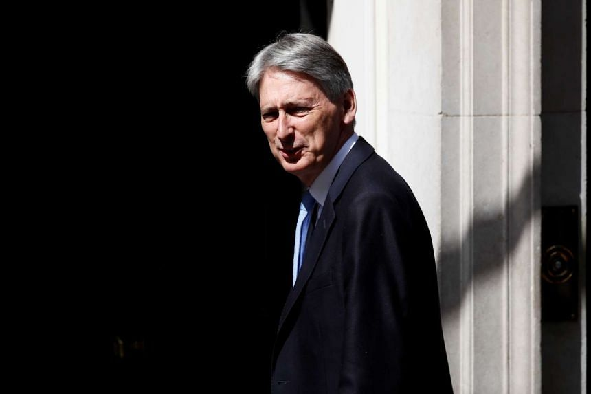 Britain's Chancellor of the Exchequer Philip Hammond arriving in Downing Street on June 13, 2017.