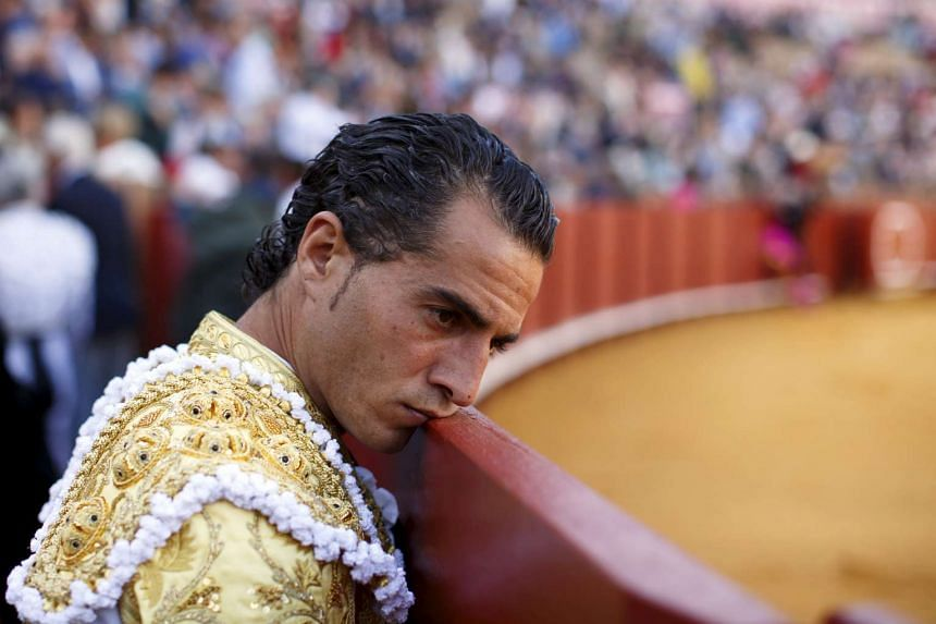 Spanish matador Ivan Fandino leans his face on the barrier during a bullfight in April 2017.