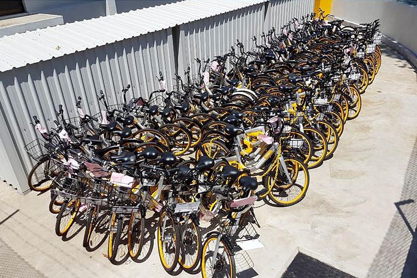 An oBike bicycle parked outside an Yishun flat in a manner that obstructs the common corridor, posing a safety hazard. Bicycles from bike-share firms which have been impounded by the Land Transport Authority. The two-wheelers, which are unlocked usin