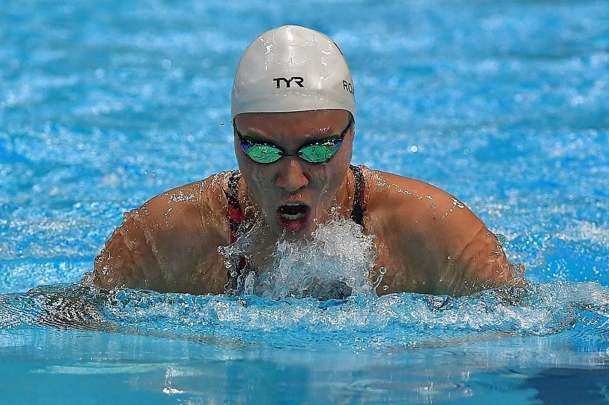 Right: National swimmer Quah Zheng Wen broke his own national record in the 200m backstroke at the Singapore National Swimming Championships heats yesterday, clocking 2:00.45 to erase his previous mark of 2:00.55. Below: Roanne Ho clocked 31.66sec in