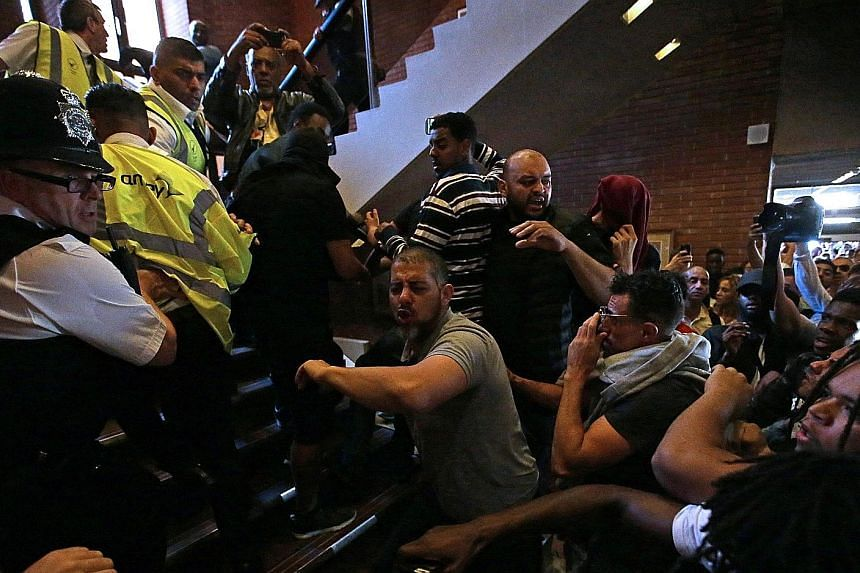 Protesters storming Kensington Town Hall in west London on Friday as they demand justice for those affected by the fire that gutted Grenfell Tower. Prime Minister Theresa May had to be rushed away from a meeting with residents of the building under h