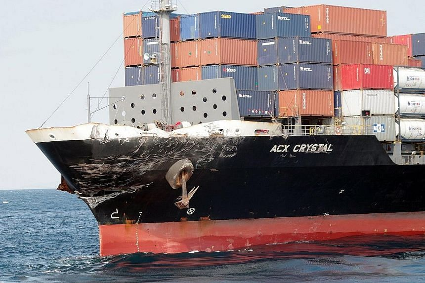 The damaged bow of ACX Crystal, the Philippine-flagged cargo ship. There were no casualties among the 20 Philippine crew. The USS Fitzgerald as seen off the Shimoda coast yesterday. The sailors were thought to have been thrown into the sea, or trappe