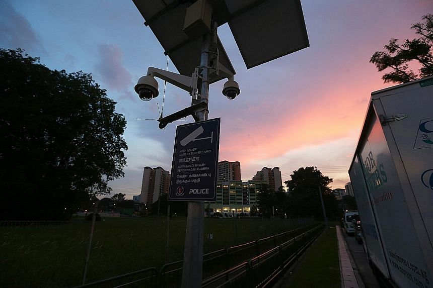 Residents of Choa Chu Kang North can now use a stretch of the Rail Corridor near Sungei Kadut Avenue (left) without being harassed, after a security camera curbed the activities of pimps and contraband cigarette sellers. But police cameras at the Yew