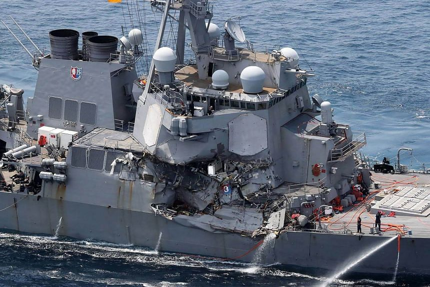 Damage is seen on the guided missile destroyer USS Fitzgerald off the Shimoda coast, after it collided with a Philippine-flagged container ship, on June 17, 2017.