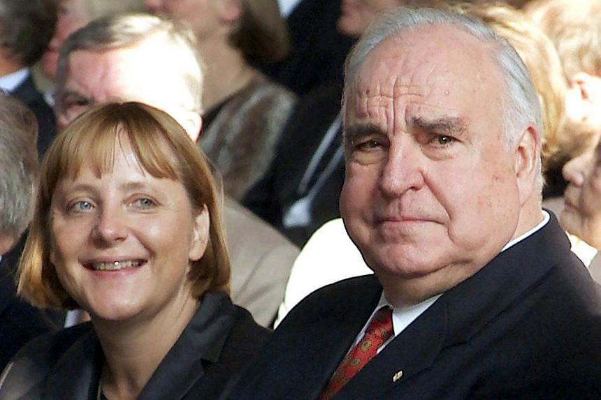 Former German Chancellor Helmut Kohl with a younger Angela Merkel during celebrations in Berlin on Sept 27, 2000, to mark the 10th anniversary of German reunification.