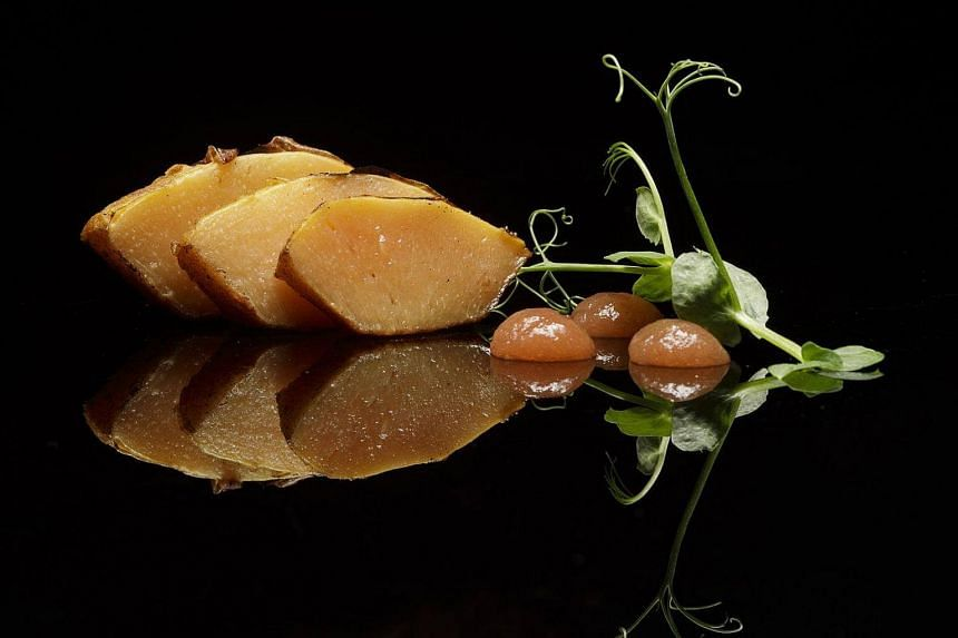 Looks like pork? Quince fossilised in calcium oxide, cooked sous vide, fried in butter till crisp. By JP Fiechtner.