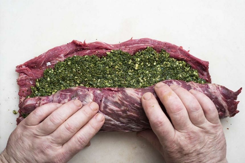Roll up the meat with the pesto and secure with kitchen string. PHOTO: NYTIMES