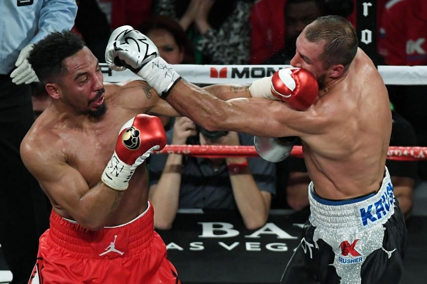 Andre Ward (left) and Sergey Kovalev trading blows during the sixth round of their light heavyweight bout in Las Vegas on June 17, 2017.