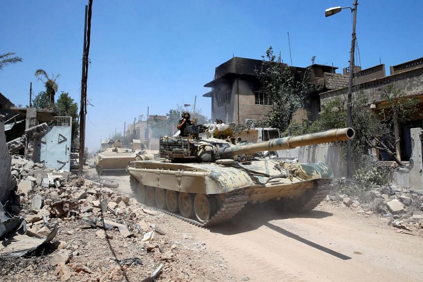 Iraqi tanks advancing towards the ISIS-held Old City in Mosul, on June 18, 2017.