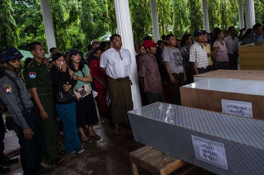Myanmar military family members crying during their relatives' funerals in Dawei on June 9, 2017.