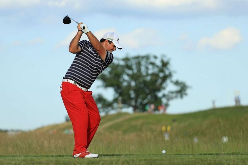 Patrick Reed plays his shot from the 17th tee during the second round.