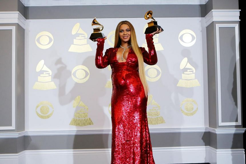 Beyonce holds the awards she won for Best Urban Contemporary Album for Lemonade and Best Music Video for Formation at the 59th Annual Grammy Awards in Los Angeles, California.