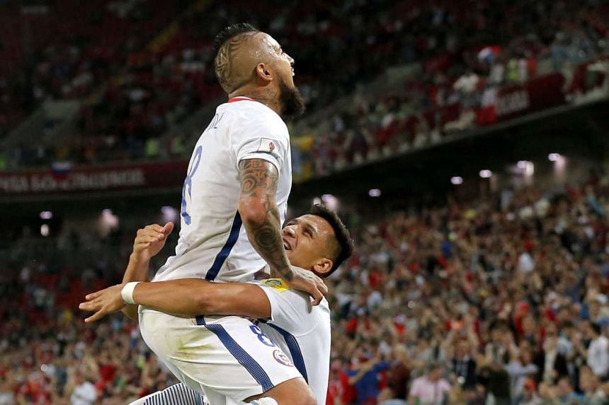Alexis Sanchez giving Chile team-mate Arturo Vidal a lift to celebrate, after providing the cross for the latter to head in the opening goal of their Confederations Cup match against Cameroon at the Spartak Stadium on June 18, 2017.