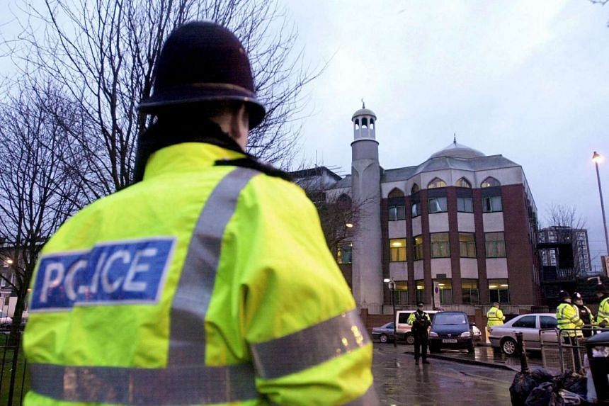 A police officer stands in front of Finsbury Park Mosque in north London, Britain, Jan 23, 2003.