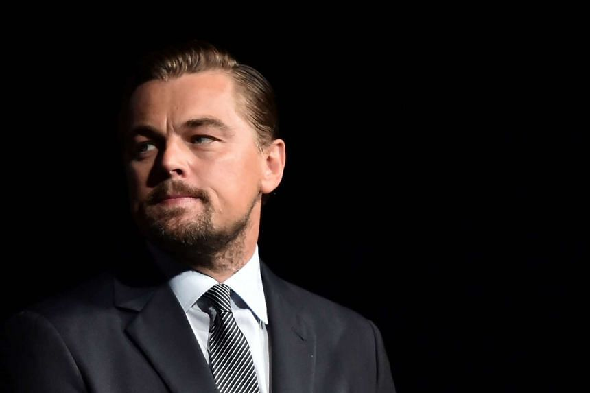 """US actor Leonardo DiCaprio looks on prior to speaking on stage during the Paris premiere of the documentary film """"Before the Flood"""" at the Theatre du Chatelet in Paris, France on October 17, 2016."""