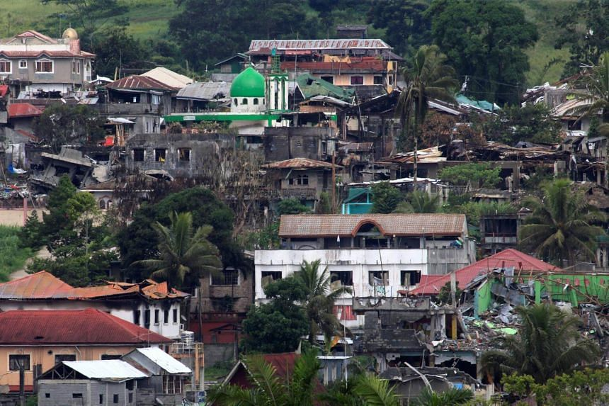 Damaged buildings and houses are seen as government forces continue their assault against insurgents from the Maute group, who was taken over large parts of the Marawi City, Philippines on June 18, 2017.
