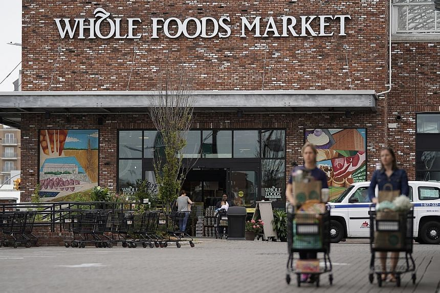 Online retailer Amazon's surprise US$13.7 billion (S$18.9 billion) acquisition of supermarket chain Whole Foods last week rattled stocks of United States retailers and food companies such as Walmart, Target, Kroger and Costco, wiping billions of doll