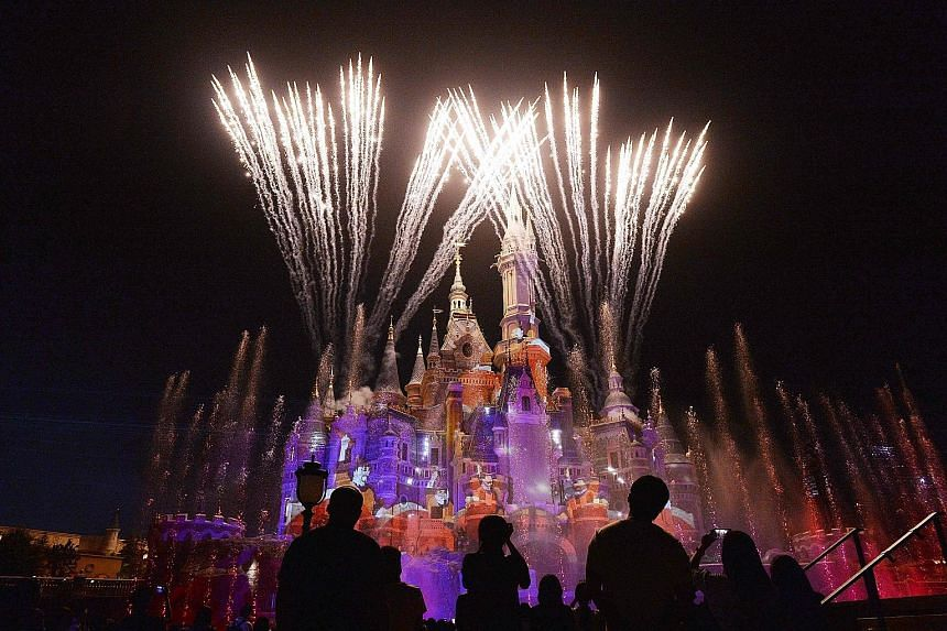 Visitors at an event marking the first anniversary of the opening of Shanghai Disneyland.