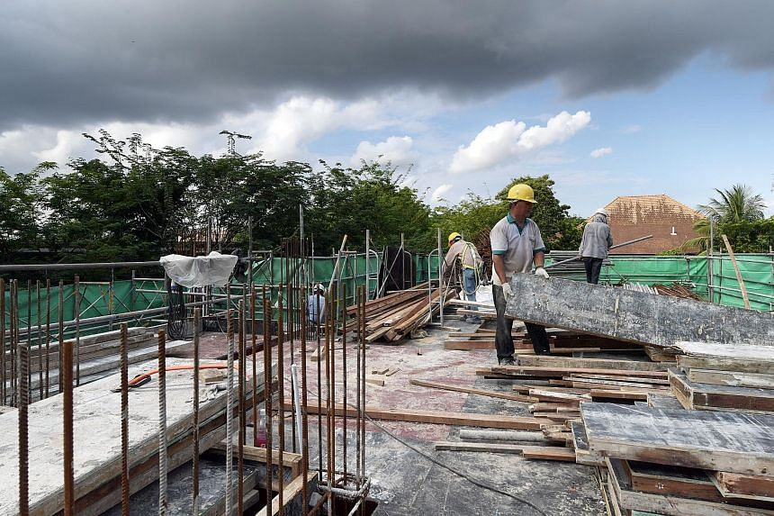 Traditional building methods being employed at a construction site. The BCA is pushing for new methods to be used which would reduce reliance on workers, such as prefabricated prefinished volumetric construction.