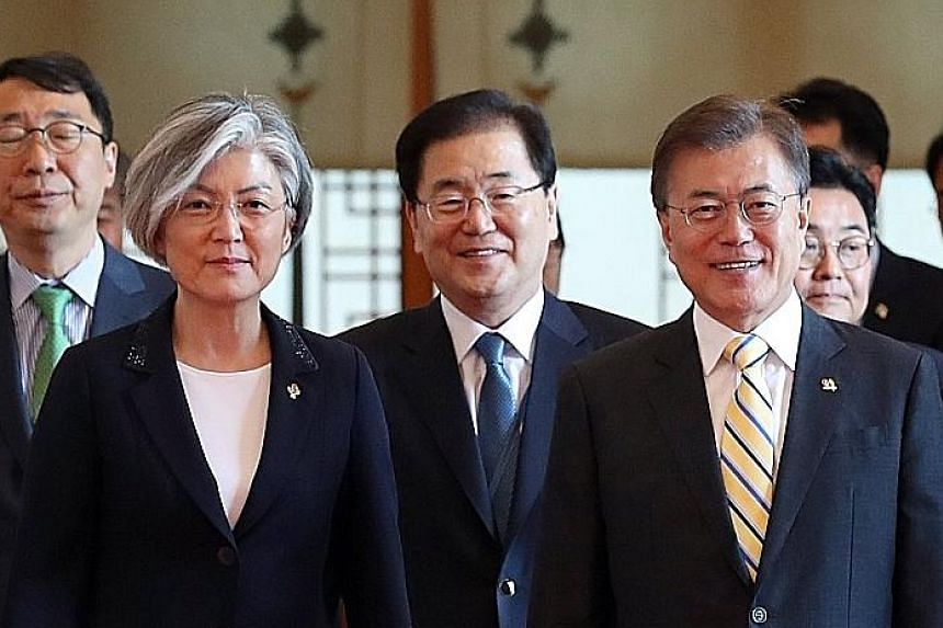 President Moon Jae In (right) and newly appointed Foreign Minister Kang Kyung Wha, after she received her appointment credentials at the presidential residence in Seoul yesterday.