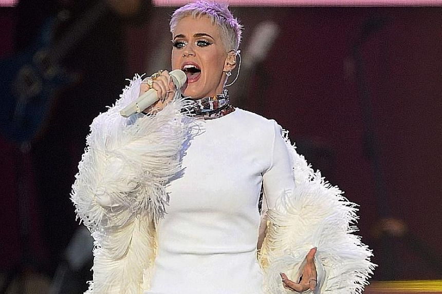 Singer Katy Perry says she is living under this crazy microscope.