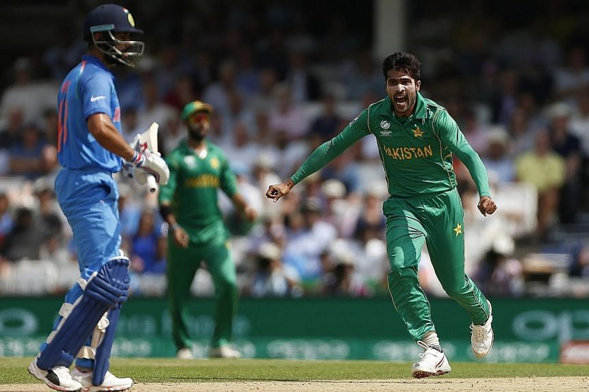 Pakistan fast bowler Mohammad Amir (right) ripped through the Indian top order at The Oval in London yesterday, claiming three wickets, including that of skipper Virat Kohli.