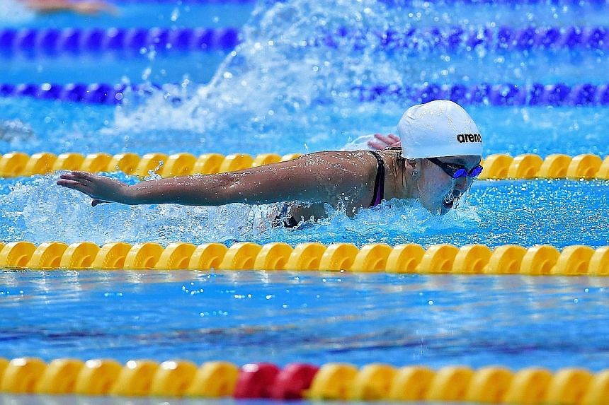 Quah Jing Wen powering her way to a national U-17 record and meet record in the 200m butterfly at the Singapore National Swimming C'ships. She won the event in 2:12.95.
