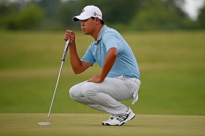 Kim Si Woo lining up a putt during the US Open third round. The South Korean had six birdies and two bogeys on Saturday.