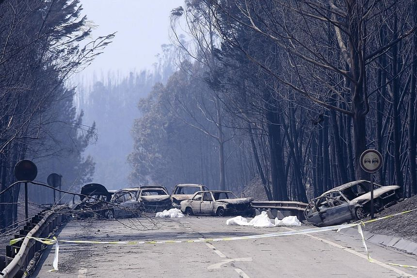 Portugal has declared three days of national mourning following a fire that started about 200km north-east of Lisbon before spreading fast across several fronts. More than 20 villages have been affected. Burnt cars and body bags on a road near the Pe