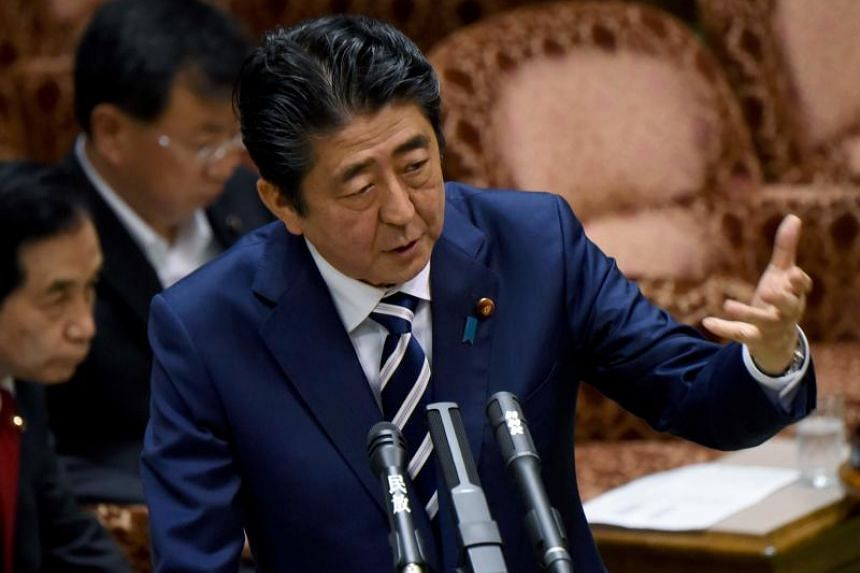 Japanese Prime Minister Shinzo Abe answering questions during the Budget Committee session in the Upper House of Parliament in Tokyo on Friday (June 16). Mr Abe is under mounting pressure over allegations  that he helped a friend get favoured treatme