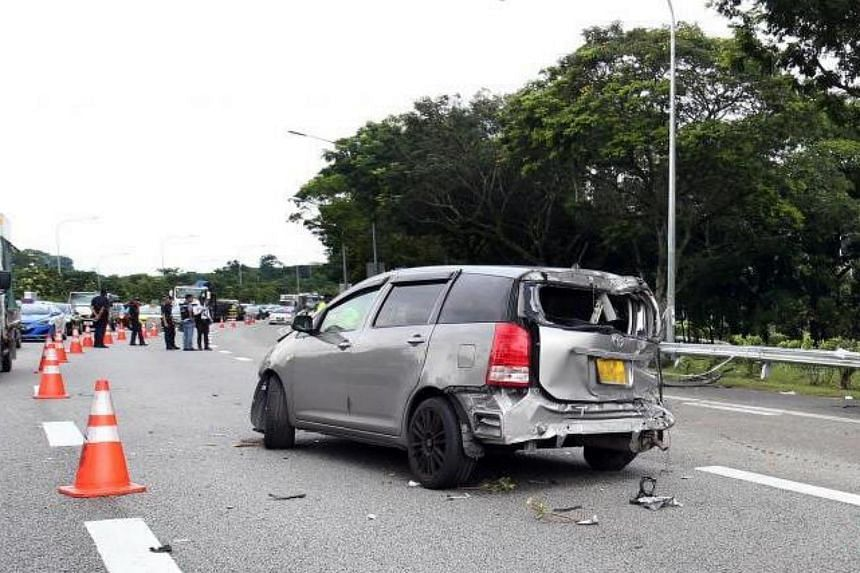 The rear of the grey-coloured Toyota MPV appeared to have been badly damaged in the accident.