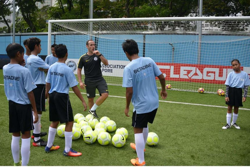 Manchester City youth coach Alan Dixon working with under-15 players at the Betadine Youth Football Development Programme at Jalan Besar Stadium.
