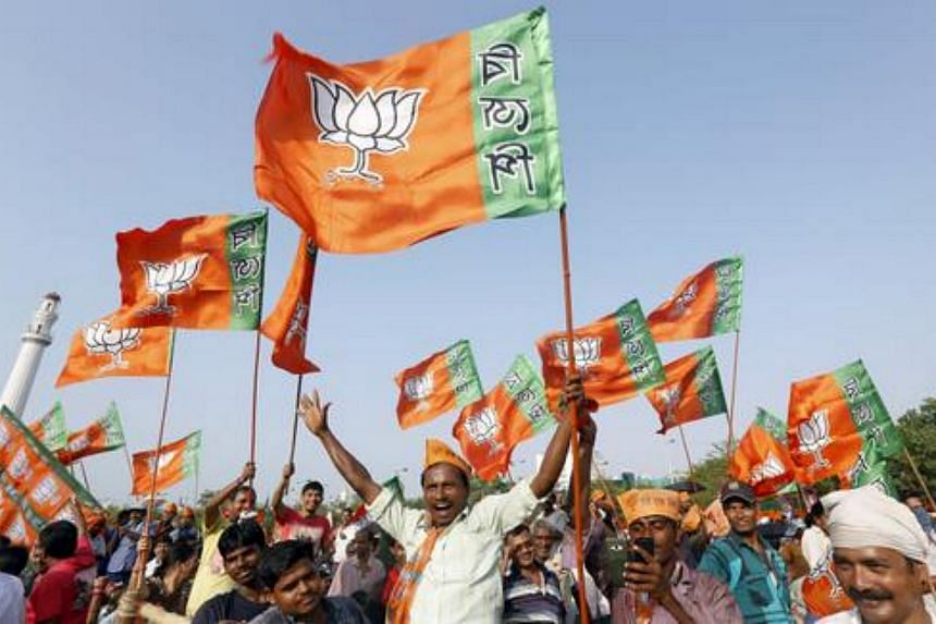 Supporters of India's ruling Bharatiya Janata Party (BJP) wave their party's flags as they wait for Prime Minister Narendra Modi to address an election campaign rally in Kolkata, India, April 17, 2016.