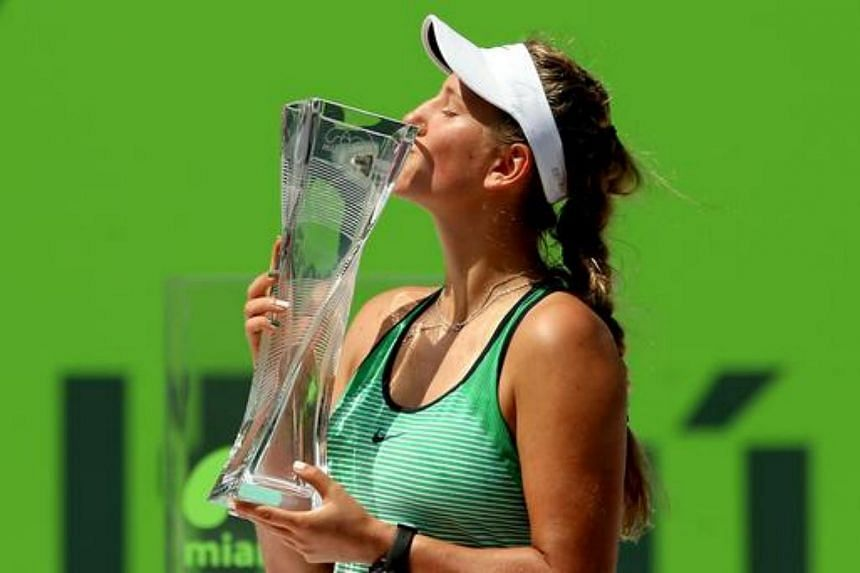 Victoria Azarenka of Belarus cekebrates with the Butch Buchholz Trophy after defeating Svetlana Kuznetsova of Russia during the women's final on Day 13 of the Miami Open on April 2, 2016 in Key Biscayne, Florida.