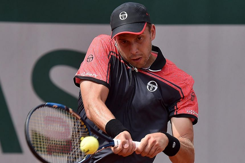 Gilles Muller of Luxembourg in action against Guillermo Garcia-Lopez of Spain during their 1st round single match during the French Open tennis tournament at Roland Garros in Paris, France, May 28, 2017.