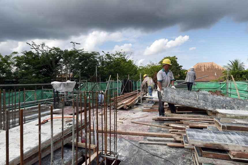 Foreign workers working for a project at Cluny Hill under Joseph Liew, General Manager of GA Construction Pte Ltd.