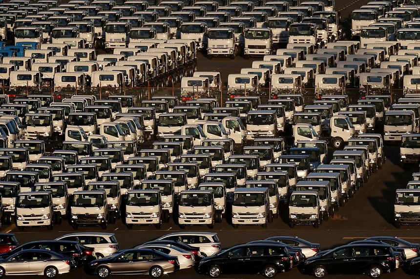 Newly manufactured cars and trucks await export at port in Yokohama, Japan.