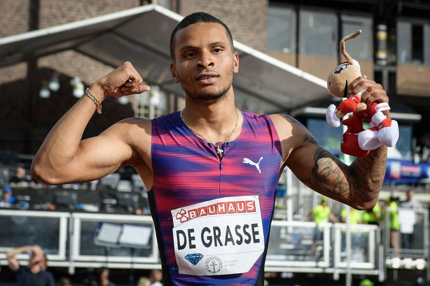Canada's Andre De Grasse poses after winning the men's 100m event in Sweden, on June 18, 2017.