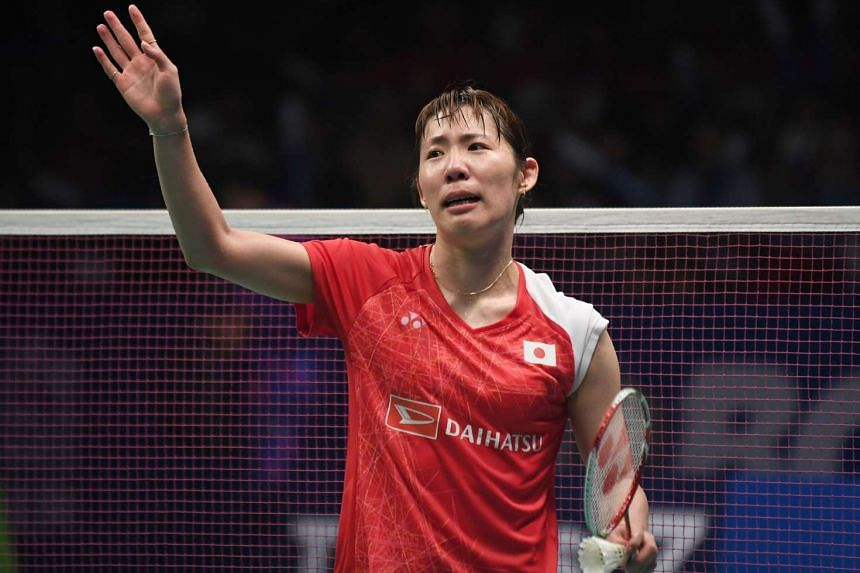 Sayaka Sato of Japan waves after winning the women's singles title of the Indonesia Open on June 18, 2017