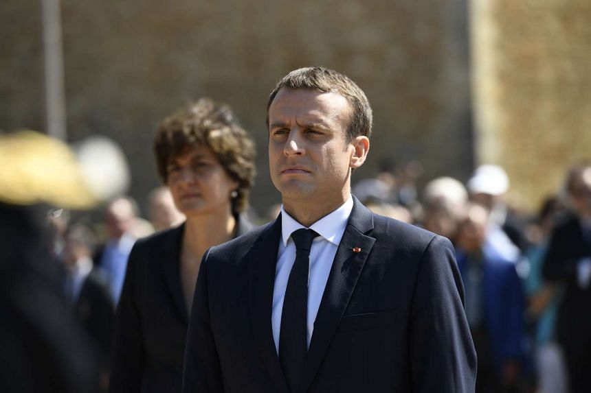French President Emmanuel Macron attends a ceremony marking a World War II anniversary as voters go to the polls on June 18, 2017.
