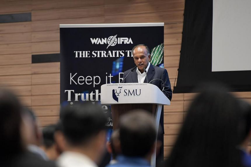 """Home Affairs and Law Minister K. Shanmugam speaking at the """"Keep It Real: Truth And Trust In The Media"""" conference on June 19, 2017."""