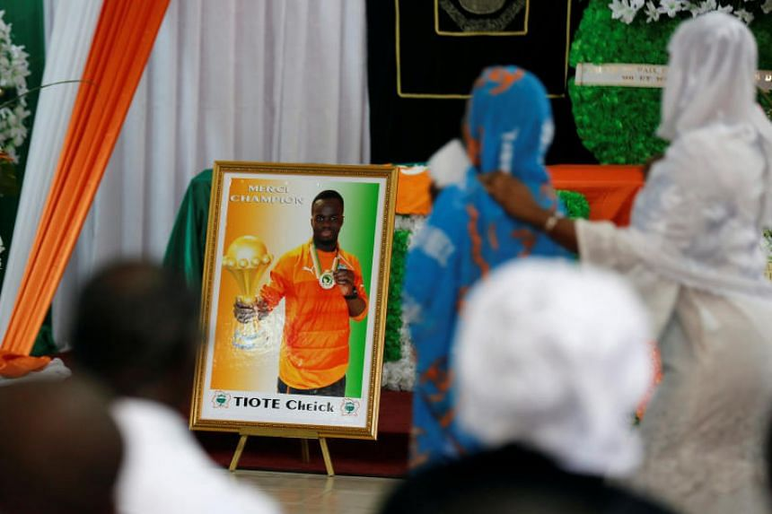 Family members of Ivorian soccer player Cheick Tiote, a former Newcastle midfielder who died during training at his club Beijing Enterprises, paying their respects at the funeral ceremony in Abidjan, Ivory Coast, on Sunday (June 18).