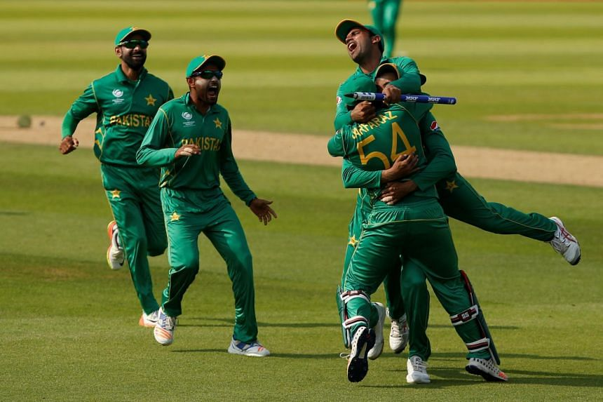 Pakistan's Sarfraz Ahmed and his teammates celebrating after defeating India to win the ICC Champions Trophy, at the Oval cricket ground in London on June 18, 2017.