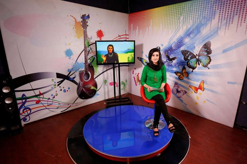 Presenter Krishma Naz, 22, recording her programme at the Zan TV (women's TV) in Kabul, Afghanistan on May 8, 2017.