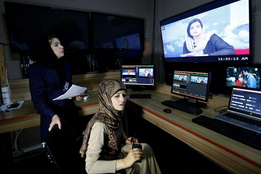Producer Khatira Ahmadi (seated), 20, working in the Zan TV (women's TV) station editing room in Kabul, Afghanistan on May 8, 2017.